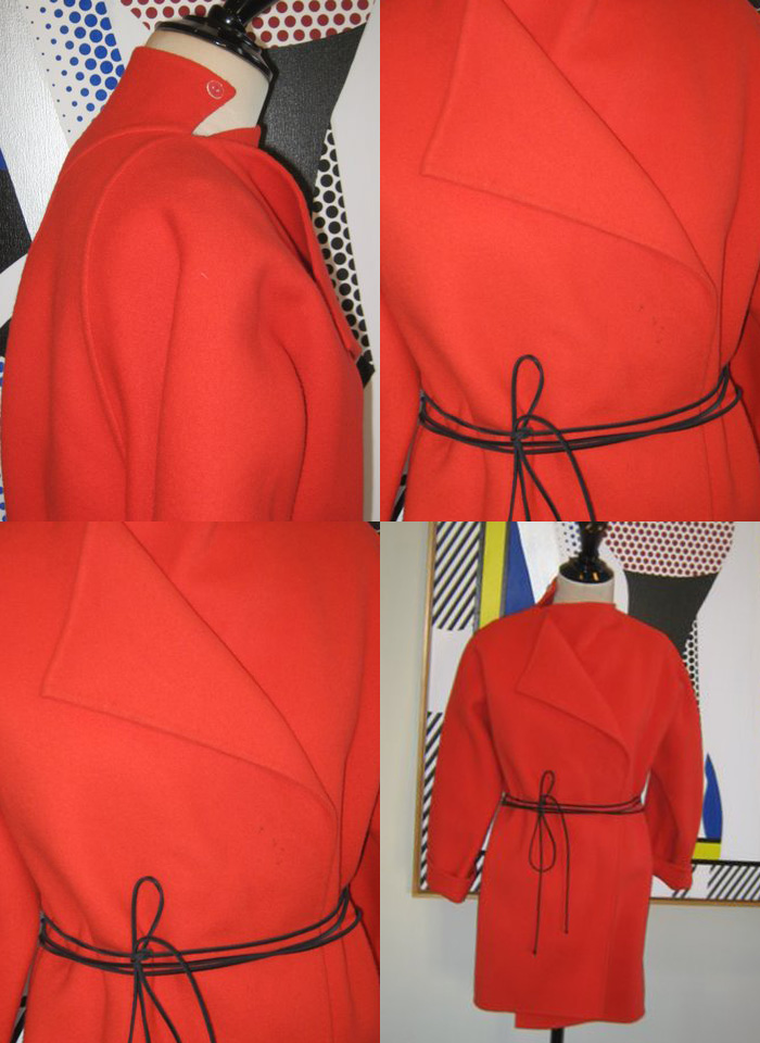 Geoffrey Beene red wool coat showing repeating motifs: tied belting and triangle slashed shapes.