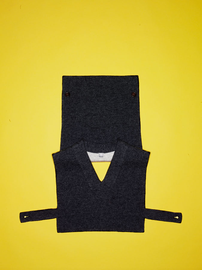 Geoffrey Beene gray wool vest with side strap and button detail.