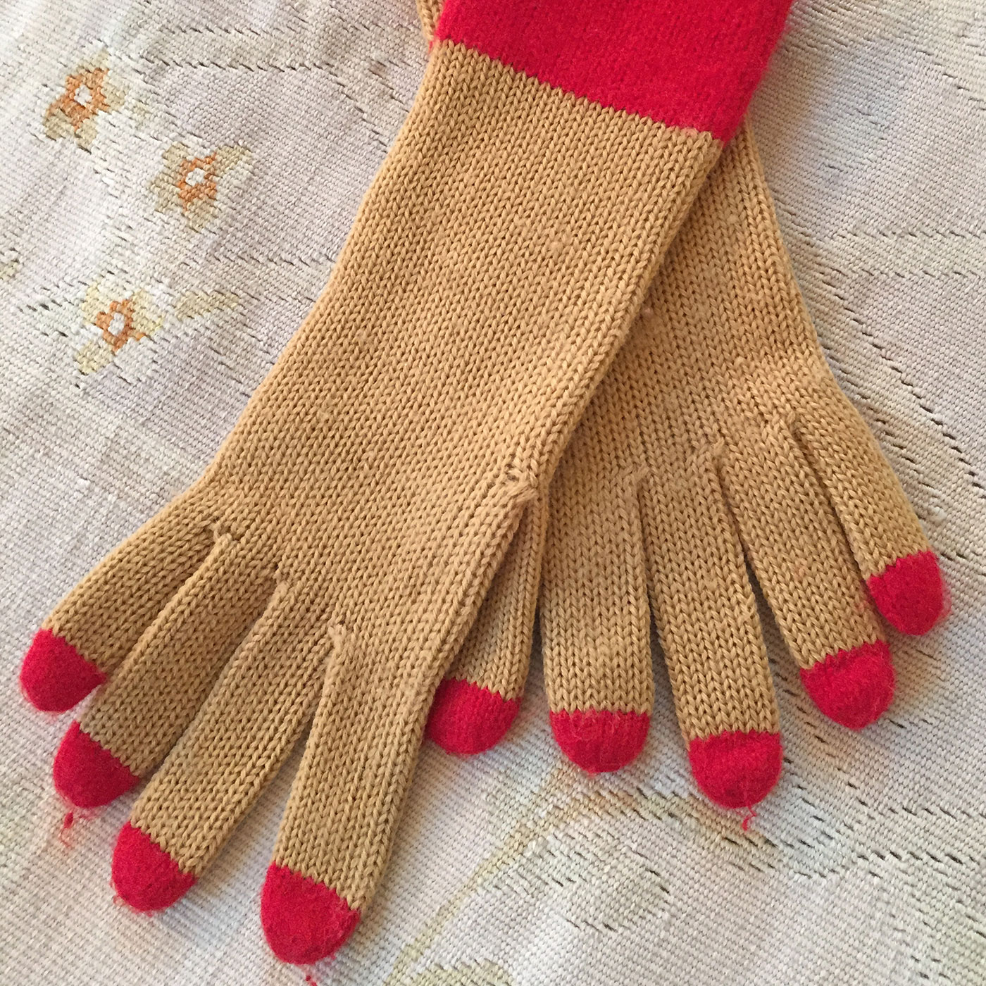 Geoffrey Beene spring wool gloves with red nail detail.