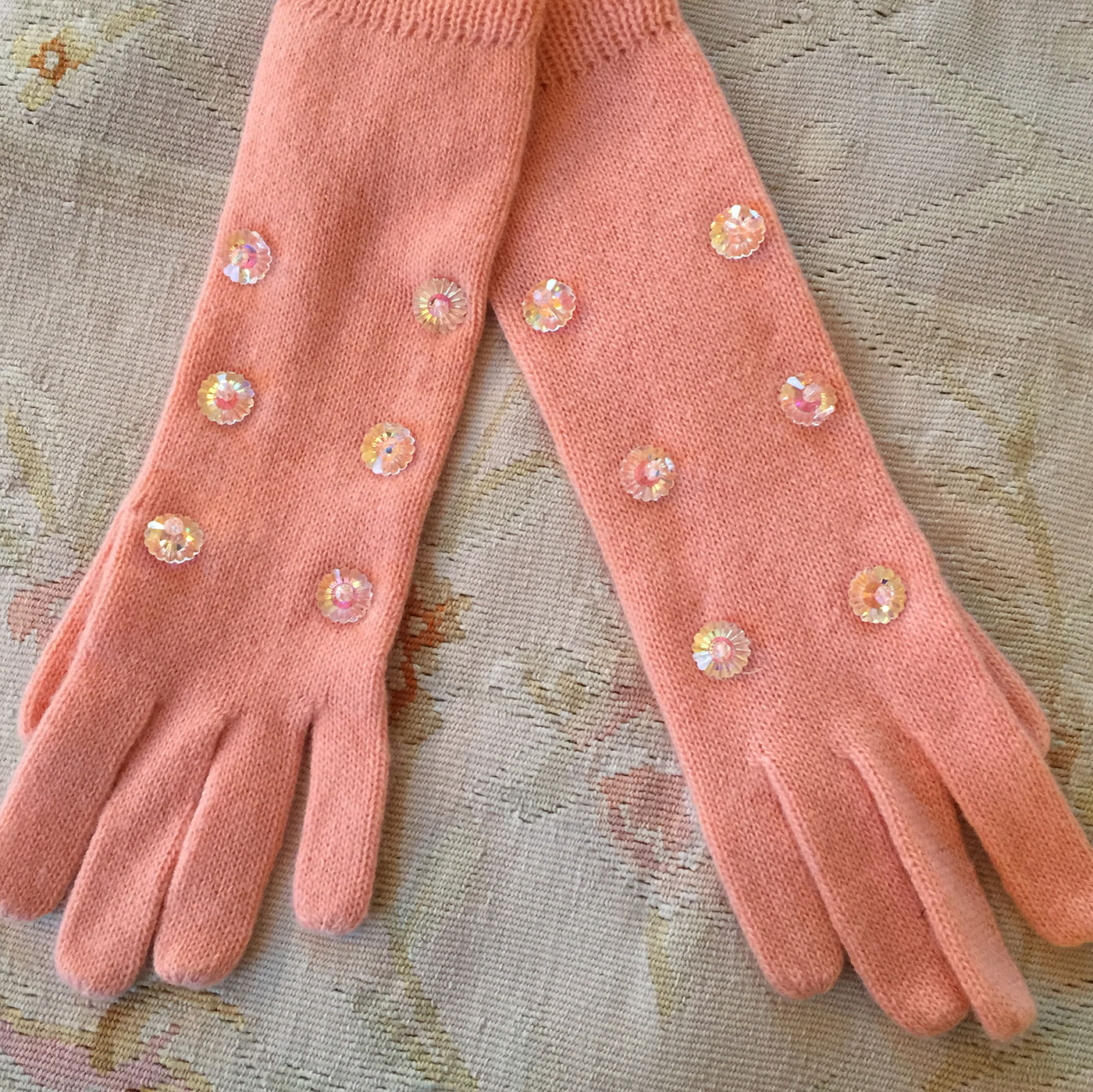Geoffrey Beene spring wool gloves with early blooms of frost across the top
